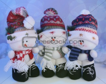 Three snowmen toys