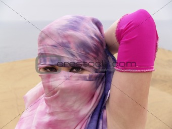 Arab dancer eyes through a veil