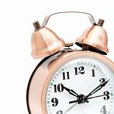 Isolated bronze vintage alarm clock