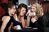 Pretty Girls Laughing in a Cafe