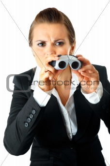 Interested modern business woman looking through binoculars