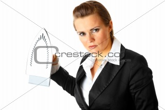 Angry modern business woman menacingly holding iron in hands