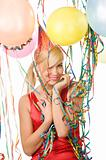 red dressed girl in party with balloons and ribbons
