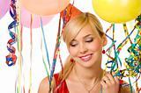 girl between ballons and ribbons