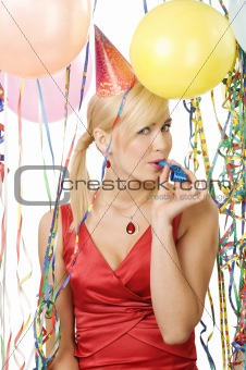 portrait of girl in red dress enjoying a party  with balloons