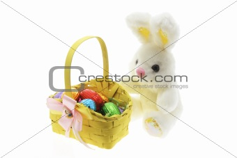 Easter Eggs in Basket with Easter Toy Bunny