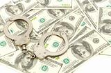 Handcuffs on money background,
