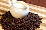 Jug of milk and coffee beans