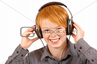 boy listening to music in headphones - isolated on white