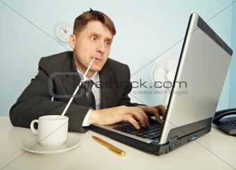 Businessman drinks coffee through a straw