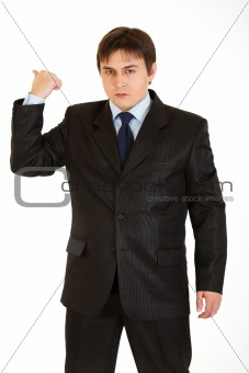 Angry businessman showing get out gesture