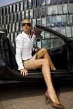 blonde businesswoman in a car