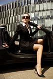 businesswoman in a cabrio
