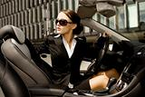 businesswoman driving a car