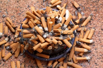 ashtray full of cigarettes close-up