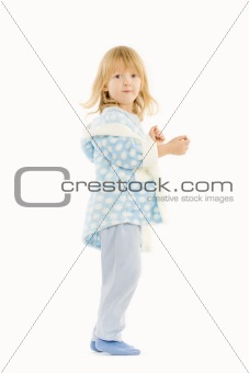 boy with long blond hair in blue bathrobe with hood - isolated on white