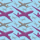 seamless pattern of colored airliners