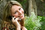The beautiful rural girl with the mobile telephone