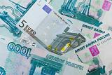 Euros and Russian roubles banknotes