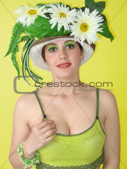 Beauty smiling girl with flowers in her hat