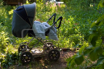 baby carriage in the garden