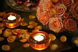 Burning Candles and Rose Petals