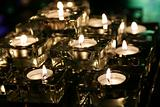 Table of Burning Candles