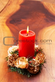 Single candle in a Christmas decoration