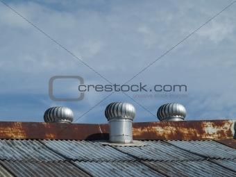 Three ventilators on a roof