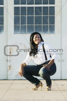 African American Woman in front of Hangar