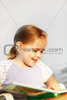 Cute child reading