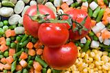 Fresh tomato on top of vegetables