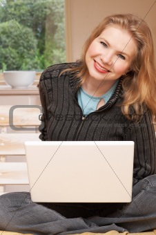 Blonde woman working on her laptop