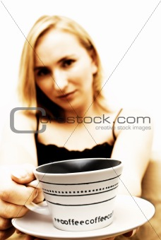 Blonde girl with coffee in her hand