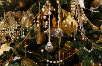 Christmas fur-tree decorated by set of gold ornaments, spheres a
