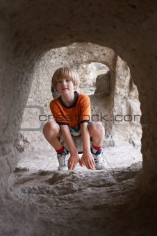 boy behind tunnel