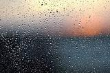 sunset through window with raindrops