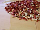 Red chili seeds and skin on yellow plate