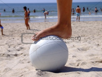 Foot on the volleyball