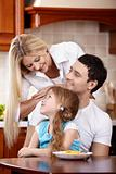 Family with the child on kitchen