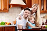 Parents with the child on kitchen