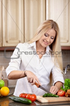 Portrait of the woman on kitchen