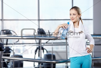 The young girl in fitness club