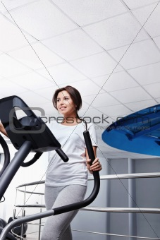 The girl on a exercise machine
