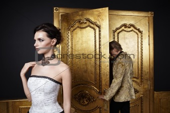 A beautiful girl looks away as a man leaves