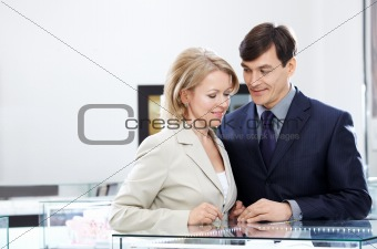 Couple before a choice in shop