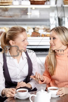 Girlfriends in cafe