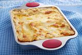 classic lasagna over blue cloth