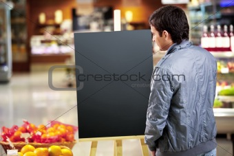 The man looking at an empty board