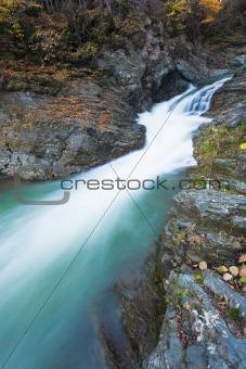 Waterfalls on Rocky Autumn Stream